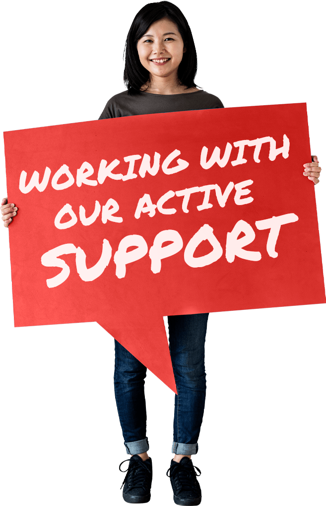 "Woman holding sign saying ""Working With Our Active Support"""