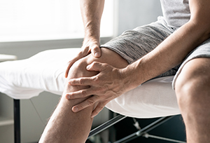 Man experiencing leg pain from sciatica